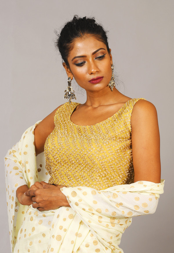 SLEEVELESS GOLDEN  BLOUSE WITH BOW